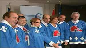 Conservative MPs wear Nordiques jerseys during a caucus meeting in Quebec City on Wednesday, Sept. 8, 2010.