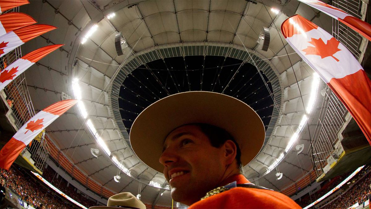 RCMP Const. Adam Carmichael looks on after the roof was opened at the renovated B.C. Place stadium before the B.C. Lions and Edmonton Eskimos CFL football game in Vancouver, B.C., on Friday September 30, 2011.