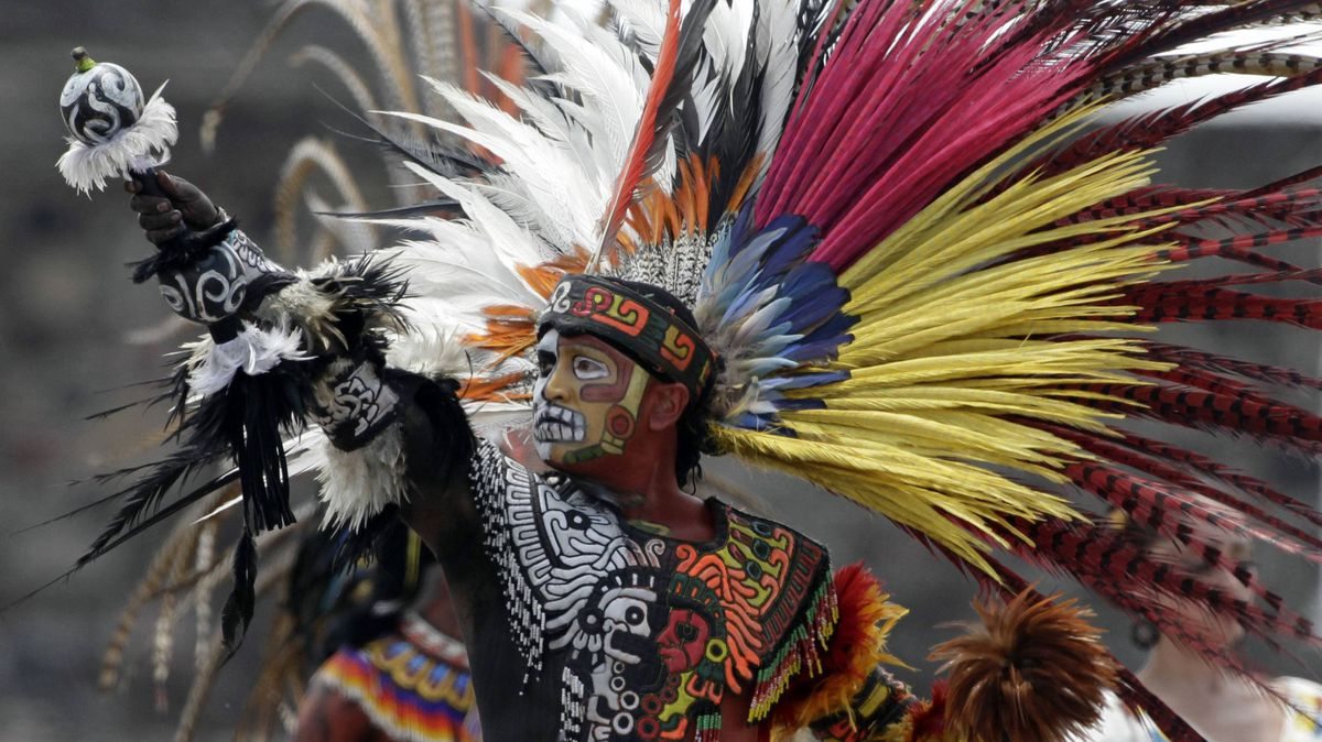 A Mexican dressed in an Aztec costume takes part in the lighting of the flame ceremony for the Pan-American games, at the Teotihuacan archaeological site, a monument of the Aztecs, about 60 km north of Mexico City, August 26, 2011.