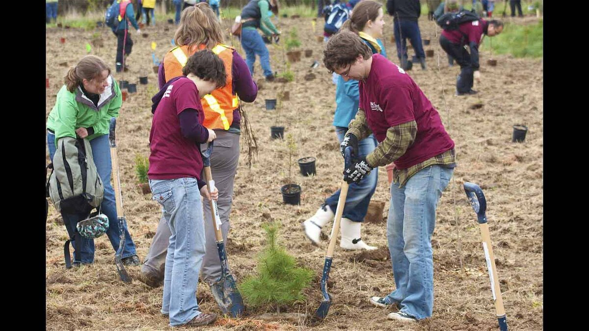 """Taken during Hamilton Earth Day, these grad students were two of the McMaster """"Dig with the Dean"""" team. Along with all the other hard working volunteers in the background, a forest was planted in aday"""