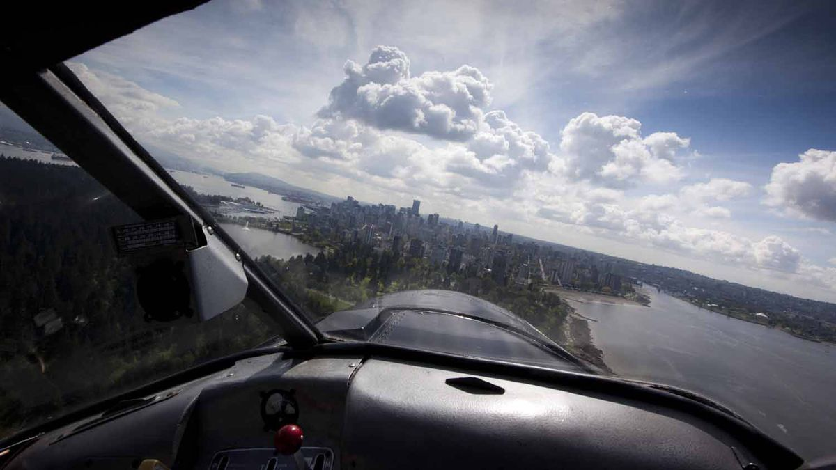 Greg McDougall CEO of Harbour Air flies his float plane in for a landing in Vancouver's harbour front May 17, 2011.