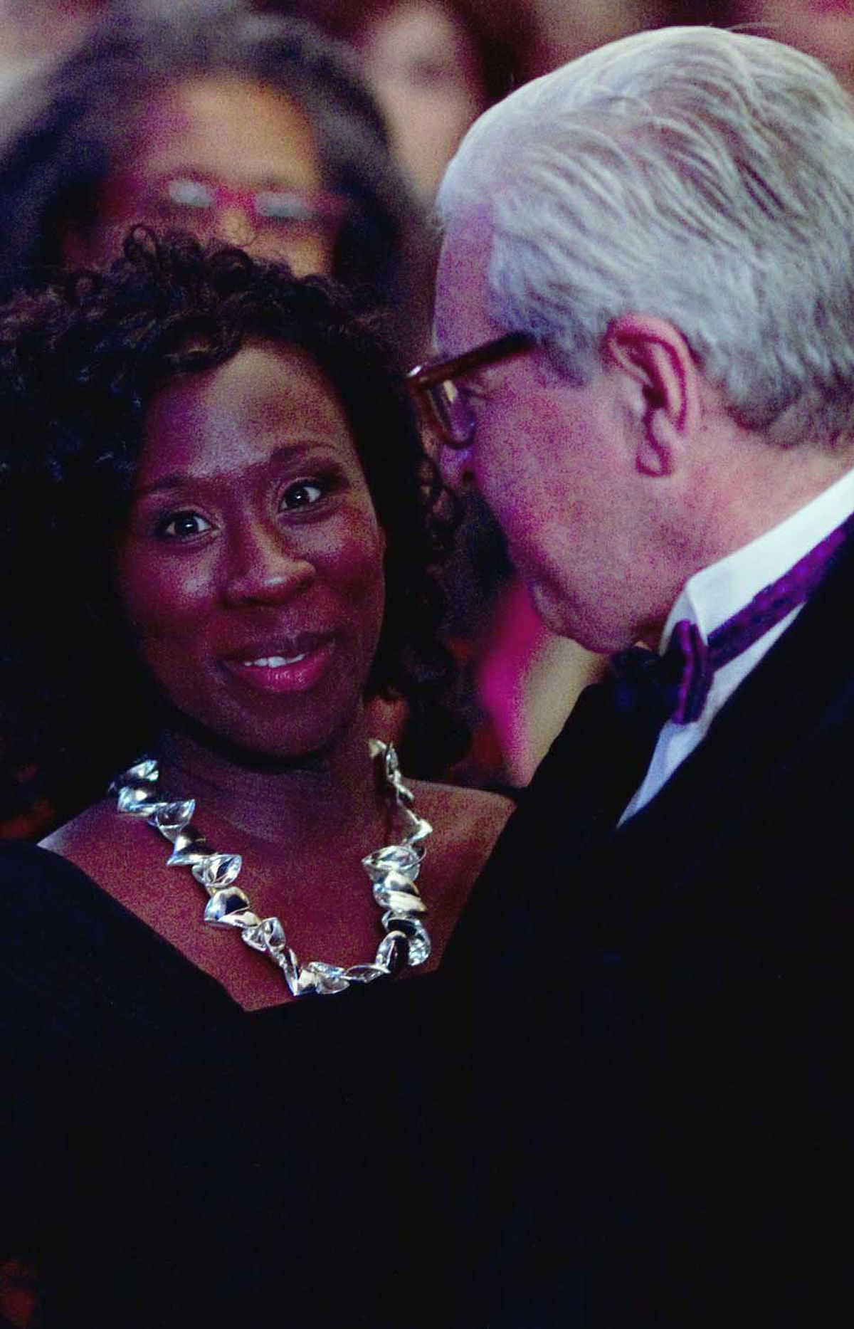 """Esi Edugyan is congratulated by her publisher, Patrick Crean of Thomas Allen, as she makes her way to the podium to accept the Giller Prize. Crean rescued """"Half-Blood-Blues"""" from obscurity after Edugyan's original publisher, Key Porter, went bankrupt."""
