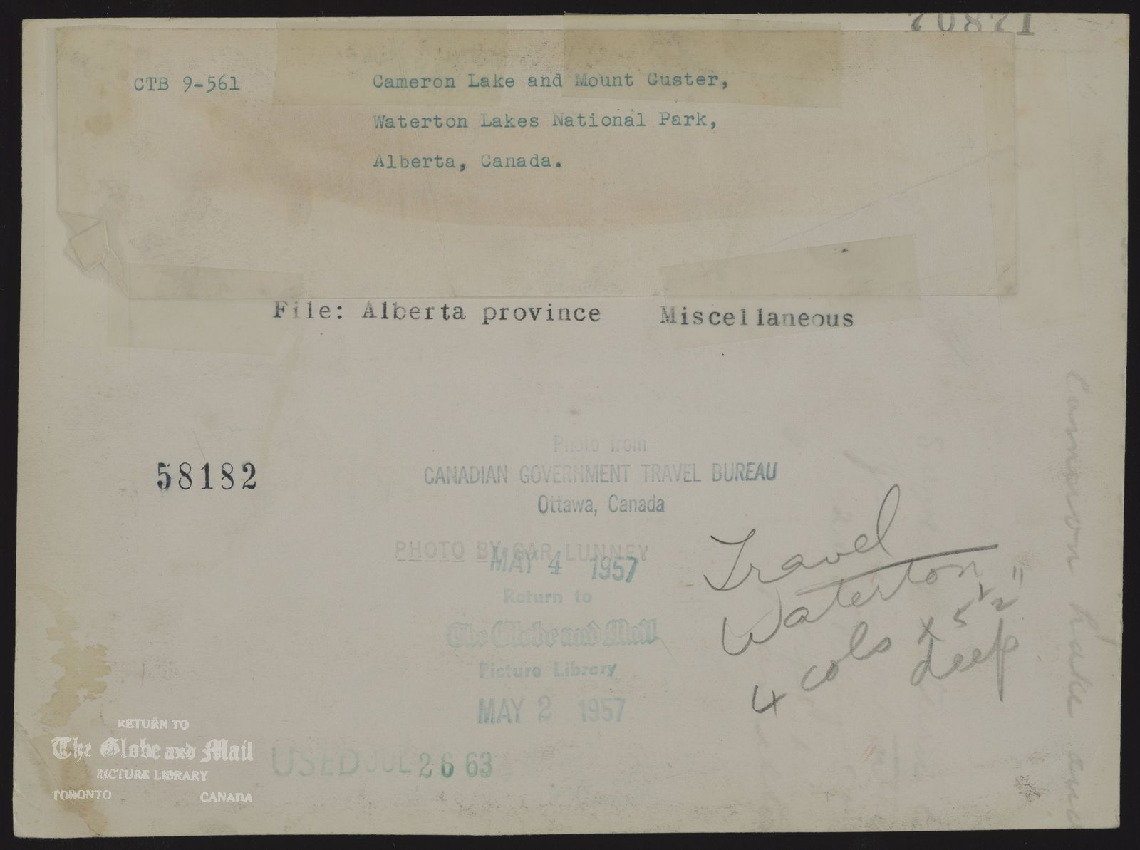 The notes written and typed on the back of this photograph, from the time it was printed, are as follows: Alberta province Miscellaneous Cameron Lake and Mount Custer, Waterton Lakes National Park, Alberta, Canada.May 2, 1957,Gar Lunny