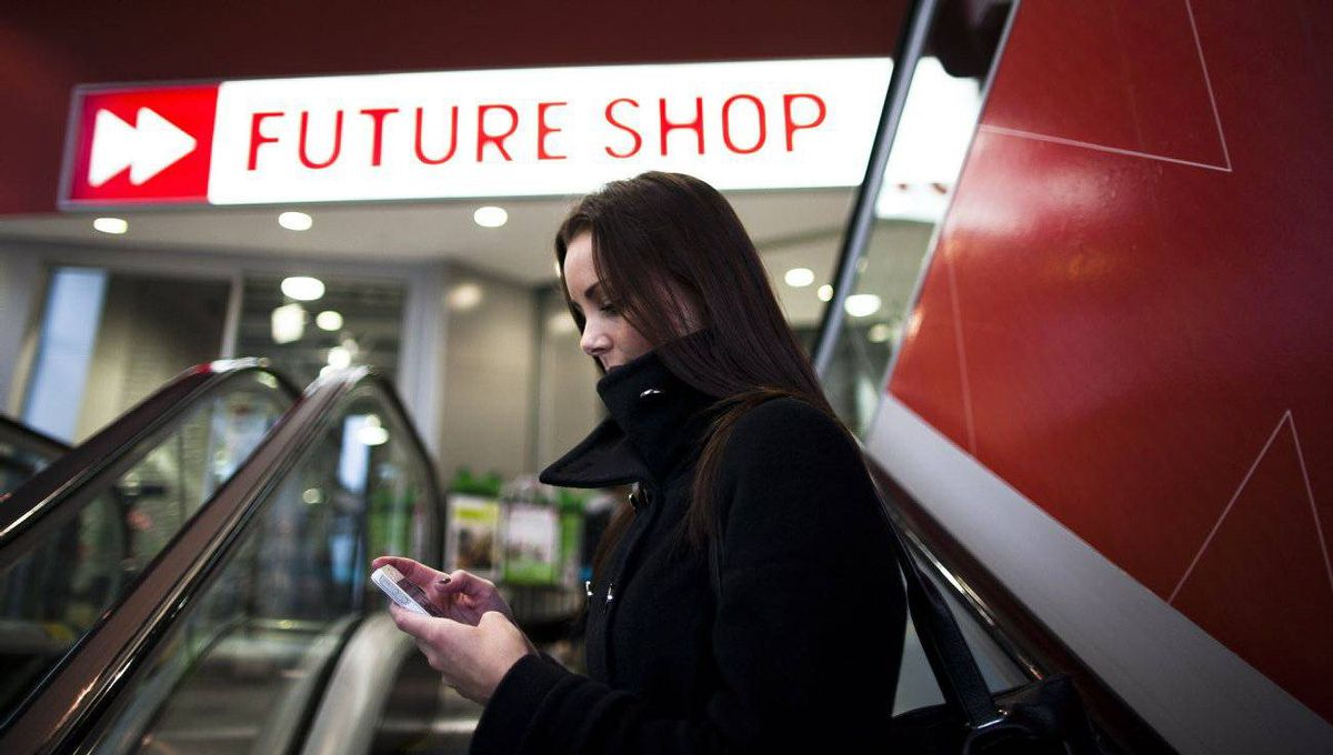 Pam Stone browses a Future Shop app on her mobile phone outside the retailer's Granville Street location in downtown Vancouver.
