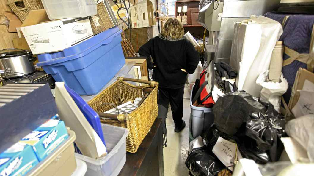 Linda is seen here in her basement where piles of belongings are stacked to the ceiling Tuesday Oct. 26, 2010.