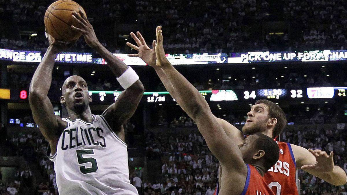 Boston Celtics forward Kevin Garnett (5) shoots against Philadelphia 76ers forward Lavoy Allen (50) and center Spencer Hawes during the second quarter. (AP Photo/Elise Amendola)
