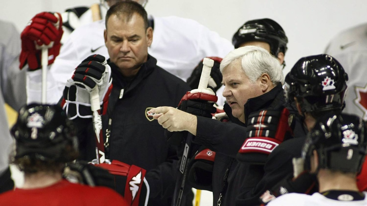 Team Canada head coach Ken Hitchcock, centre right, explains a drill as associate coach Pat Burns, centre left, looks on during a practice session Friday April 25, 2008 at the Colisee Pepsi in Quebec. THE CANADIAN PRESS/Jacques Boissinot