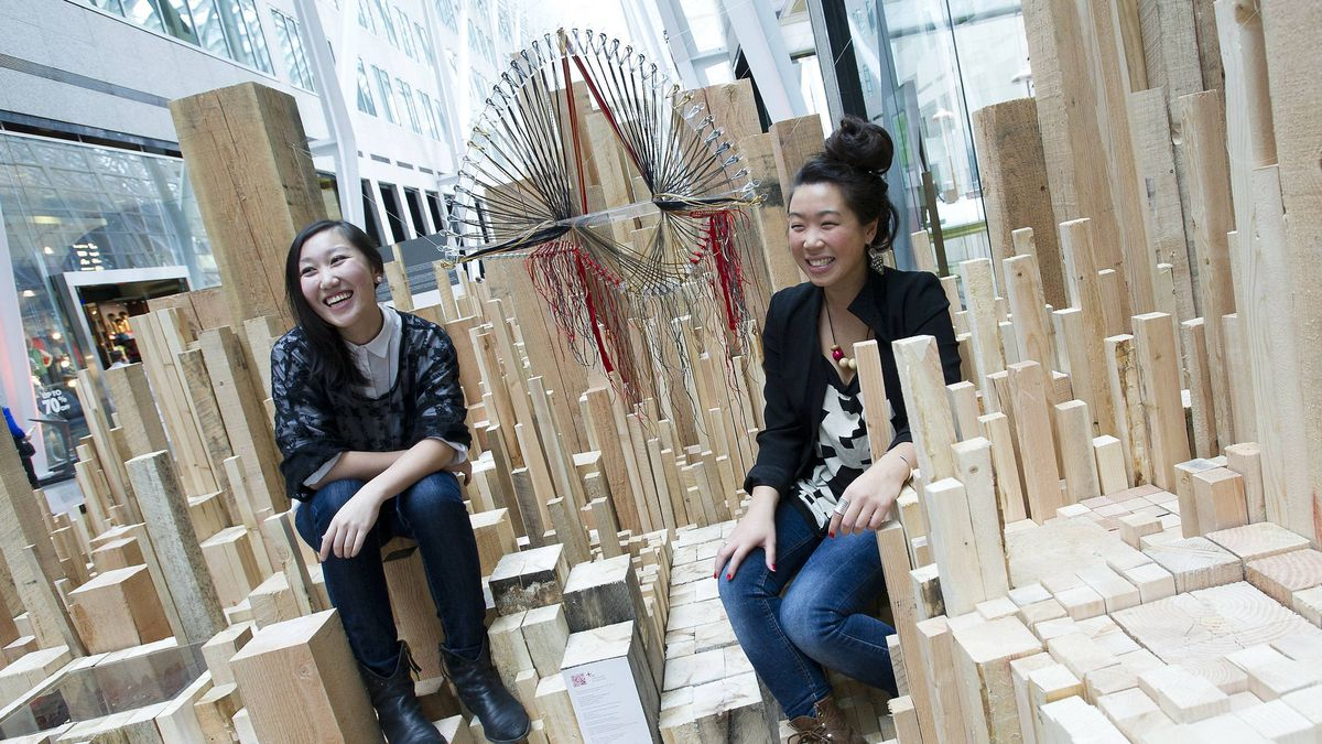 Bi-Ying Miao, left, and Jane Wong are photographed with their exhibit in Toronto, at Migrating Landscapes