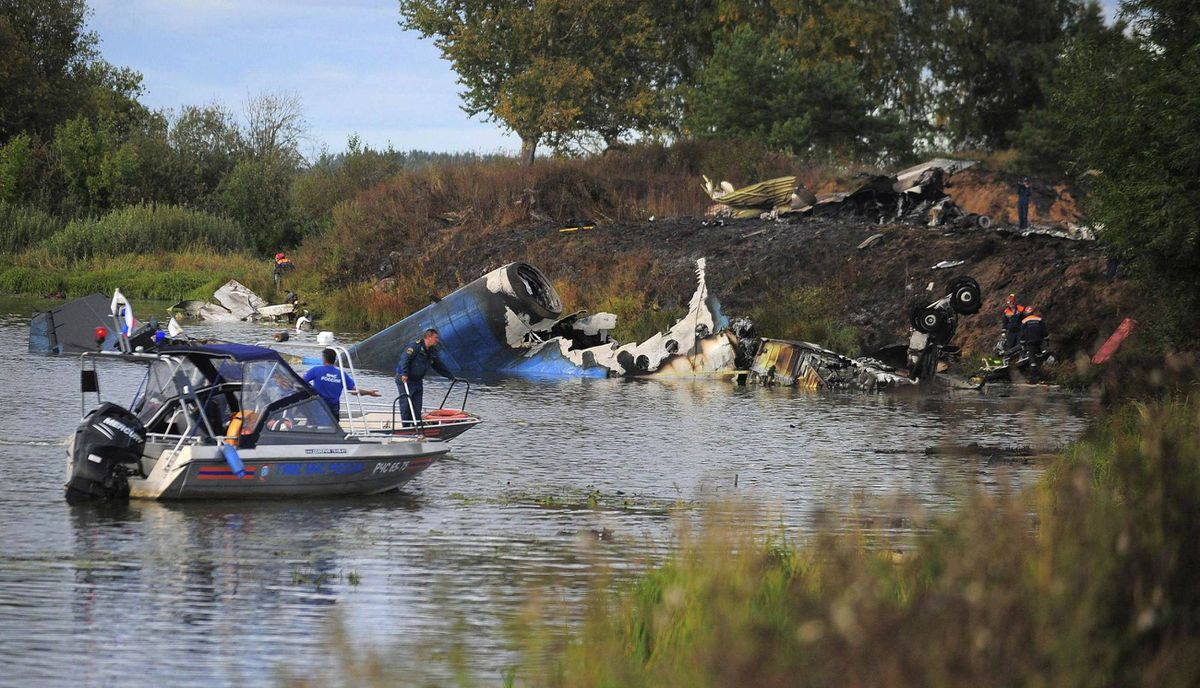 Emergency workers search the wreckage of a plane that crashed near the Russian city of Yaroslavl September 7, 2011.