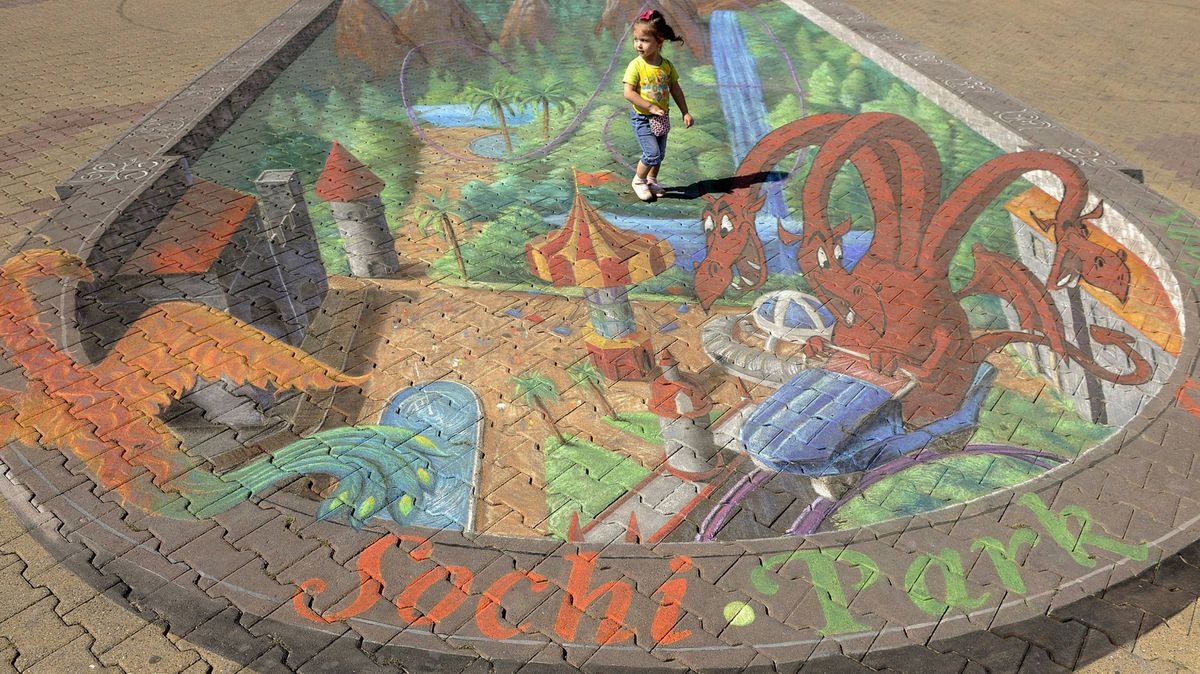 A girl stands on a grafitti painted by a US artist Tracy Lee Stum in Russian Black Sea resort of Sochi, on September 18, 2011. 3D chalk artist Tracy Lee Stum is one of the world's foremost interactive 3D street painter.