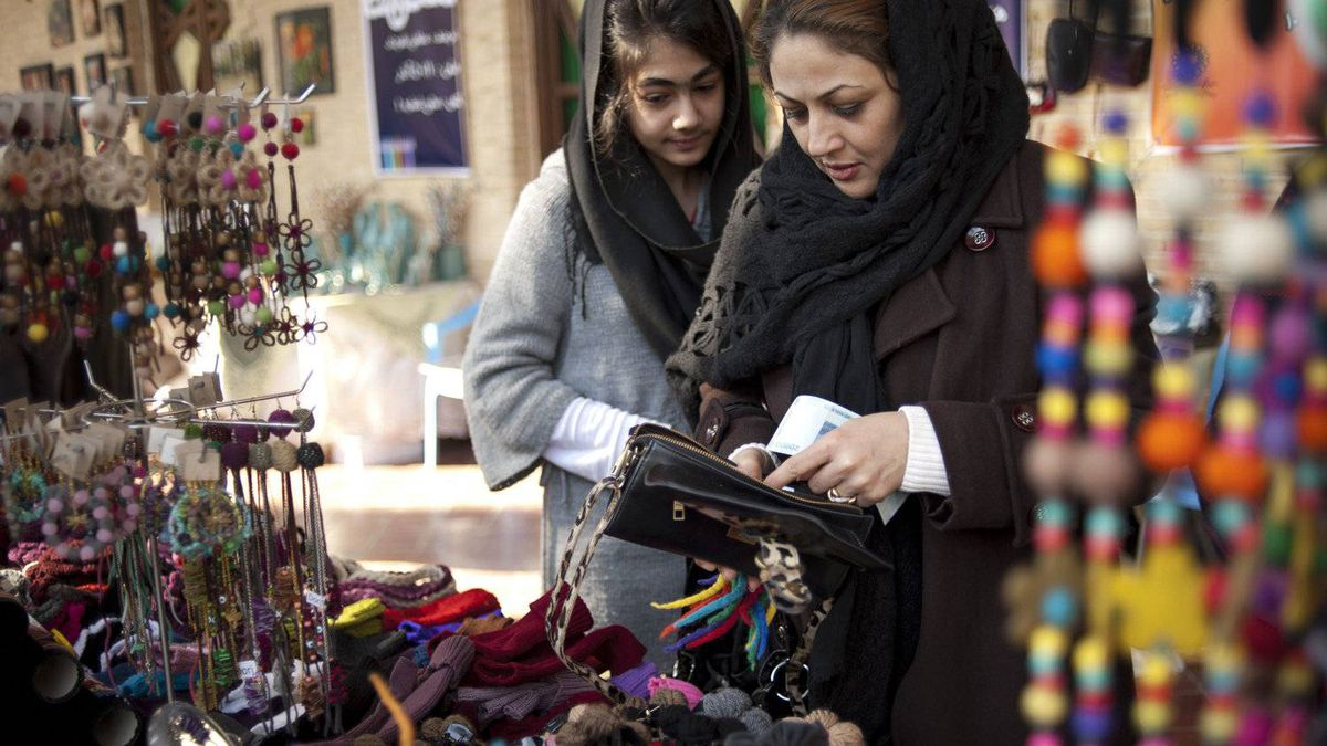 Ranaa and her mom shop at a flea market. With the rising prices and inflation, shopping has become harder, even for those from wealthier families.