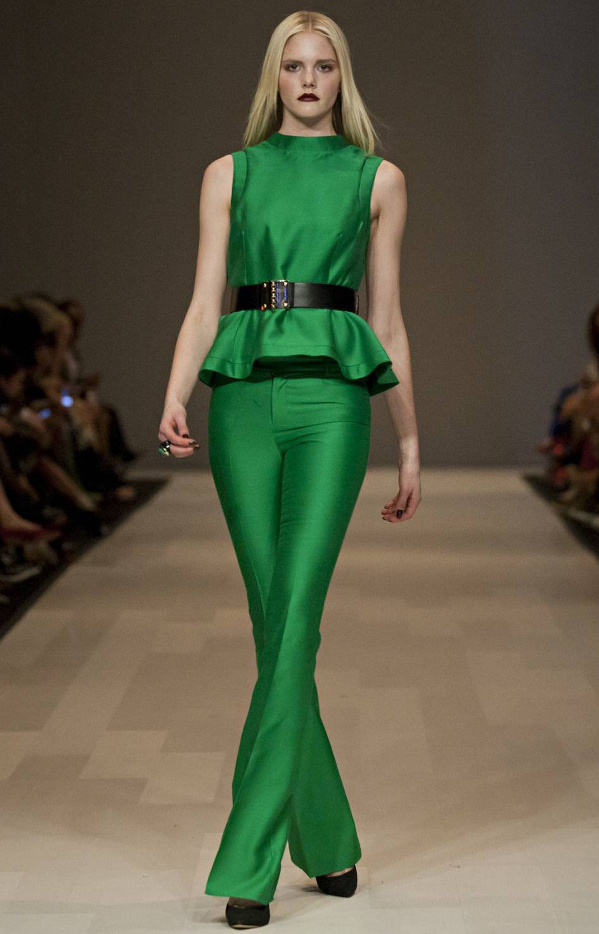Feminine vintage details such as peplums popped up throughout, most notably in a green silk suit. The monochromatic effect – and there was a lot of it – was often repetitive, but the jewel-toned separates could easily be mixed in with the label's other pieces (and into customer's closets).