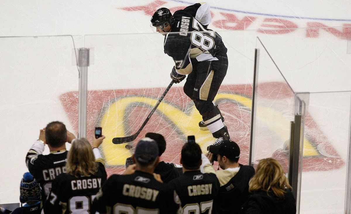 Fans watch as Sidney Crosby of the Pittsburgh Penguins takes the ice for warmups against the New York Islanders for the first time since sustaining a concussion on January 5 during the game on November 21, 2011 at CONSOL Energy Center in Pittsburgh, Pennsylvania.