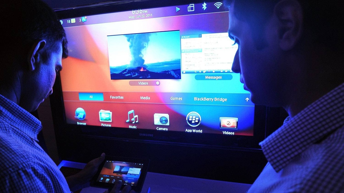 Indians try out the new BlackBerry 'PlayBook' during its launch in Mumbai on June 22, 2011.