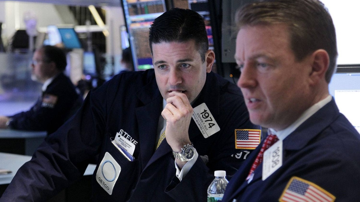 Traders work on the floor at the New York Stock Exchange on Tuesday, March 6, as stocks suffered their biggest losses of the year.