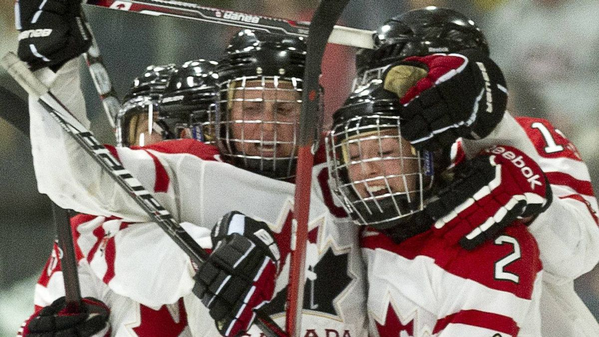 Team Canada's Meghan Agosta (2) is congratulatred by teammate Hayley Wickenheiser after scoring the tying goal against Team USA during third period gold medal hockey action at the World Women's Ice Hockey Championships Saturday, April 14, 2012 in Burlington, Vermont. THE CANADIAN PRESS/Paul Chiasson