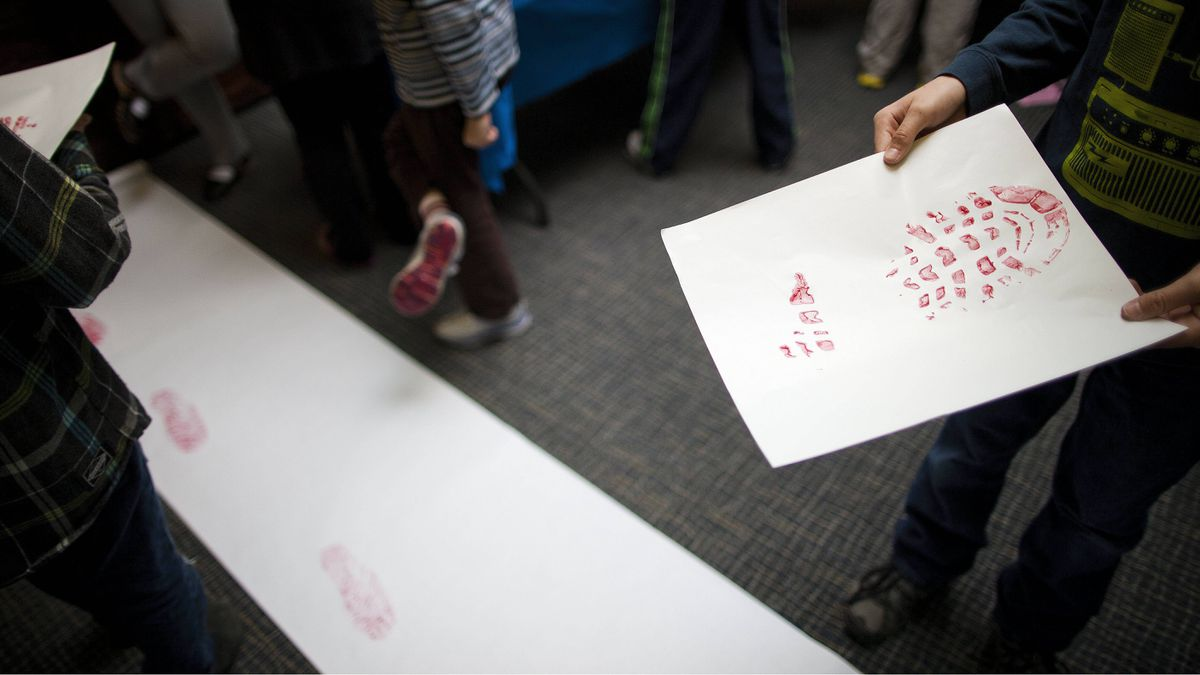 Students collect and identify footprints during a class at the Vancouver Police Museum on March 15.