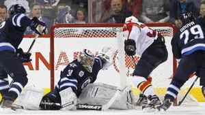 Winnipeg Jets goaltender Ondrej Pavelec (31) shuts down Florida Panthers' Kris Versteeg (32) as Jets' Randy Jones (12) and Johnny Oduya (29) look for the rebound during second period NHL action in Winnipeg on Saturday, January 21, 2012.