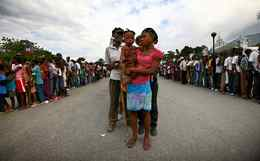 Guarded by Uruguayan soldiers under the mandate of United Nations, thousands of Haitians line up outside of the Presidential Palace in Port-Au-Prince, Haiti, waiting a delivery of food.