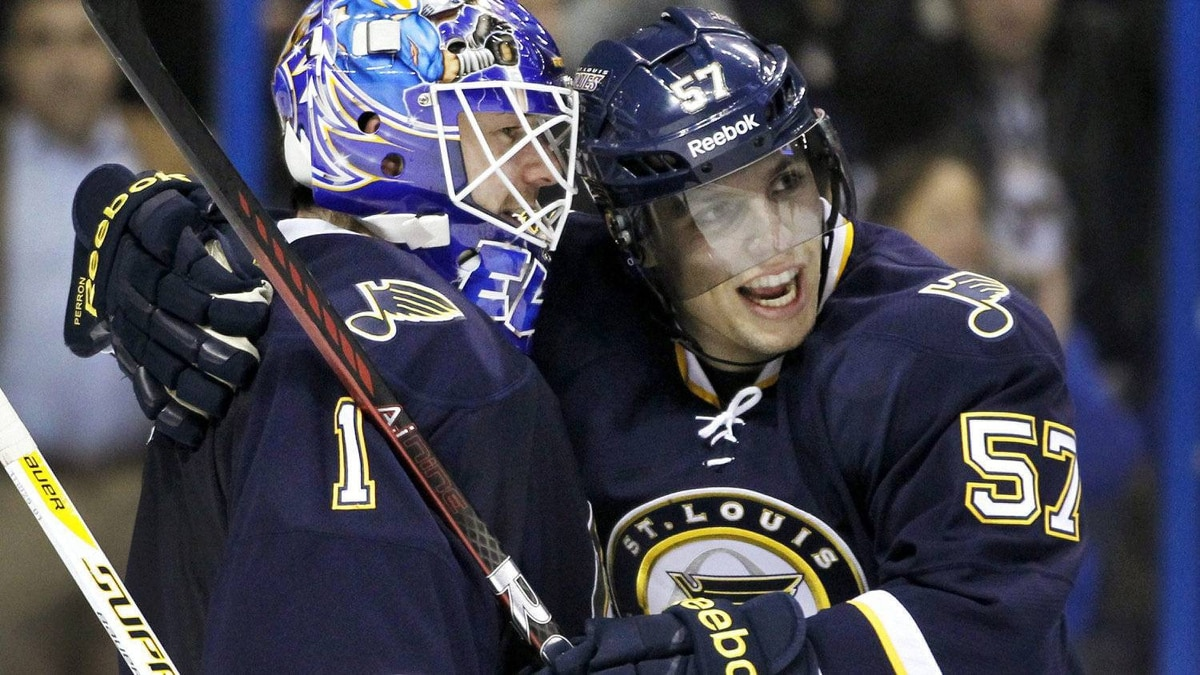 St. Louis Blues' David Perron, right, and goalie Brian Elliott celebrate after the Blues' 1-0 victory over the San Jose Sharks in an NHL hockey game, Saturday, Dec. 10, 2011, in St. Louis. (AP Photo/Jeff Roberson)