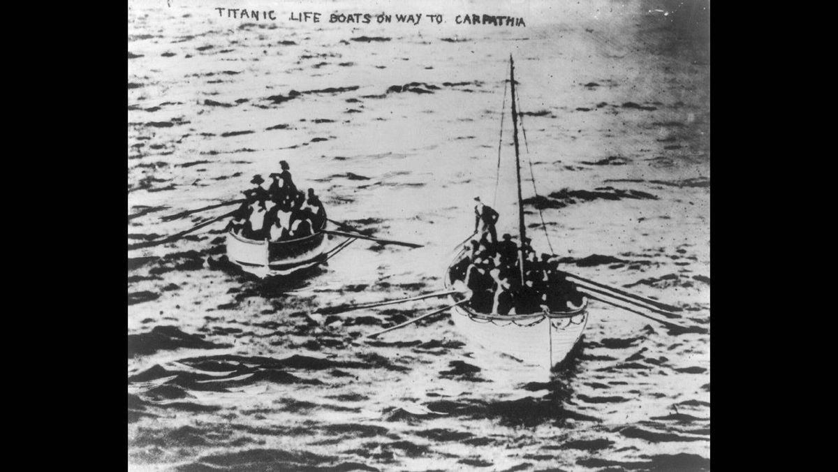 Titanic lifeboats on their way to the Carpathia following the sinking of the Titanic April 15, 1912. The Titanic was considered unsinkable but foundered in frigid Atlantic waters off Newfoundland after striking an iceberg.