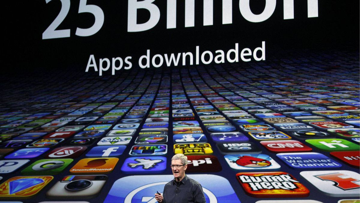 Apple CEO Tim Cook speaks about the number of apps downloaded during an Apple event in San Francisco, March 7, 2012.