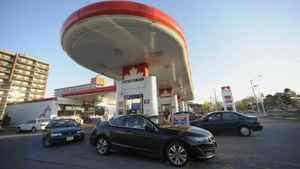 Motorists at a gas station at Overlea Blvd and Leaside Park Crescent fill their tanks.