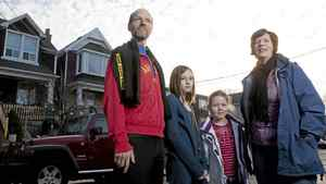 TORONTO: JANUARY 7, 2012 - Alexandra Macqueen poses for a photograph with her husband, Warren Huska, and their two children, Lark, nine, and Frances, seven, outside of their Ashdale Avenue home in Toronto on Saturday, January 7, 2012. Macqueen, a certified financial planner, coauthored a book called Pensionize Your Nest Egg.