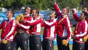 Members of the Canadian team sing the national anthem after receiving their gold medals during rugby sevens finals on the last day of the Pan American Games in Tlaquepaque, Oct. 30, 2011.
