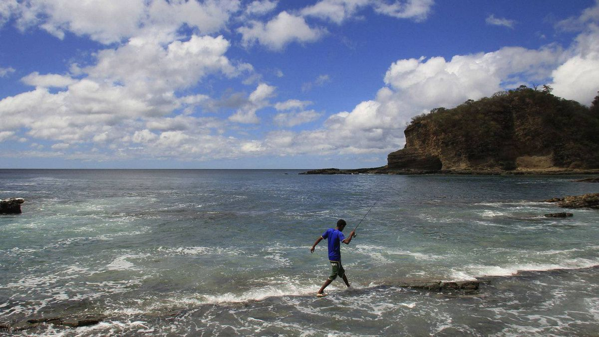 A tourist fishes on the Maderas beach in Nicaragua.