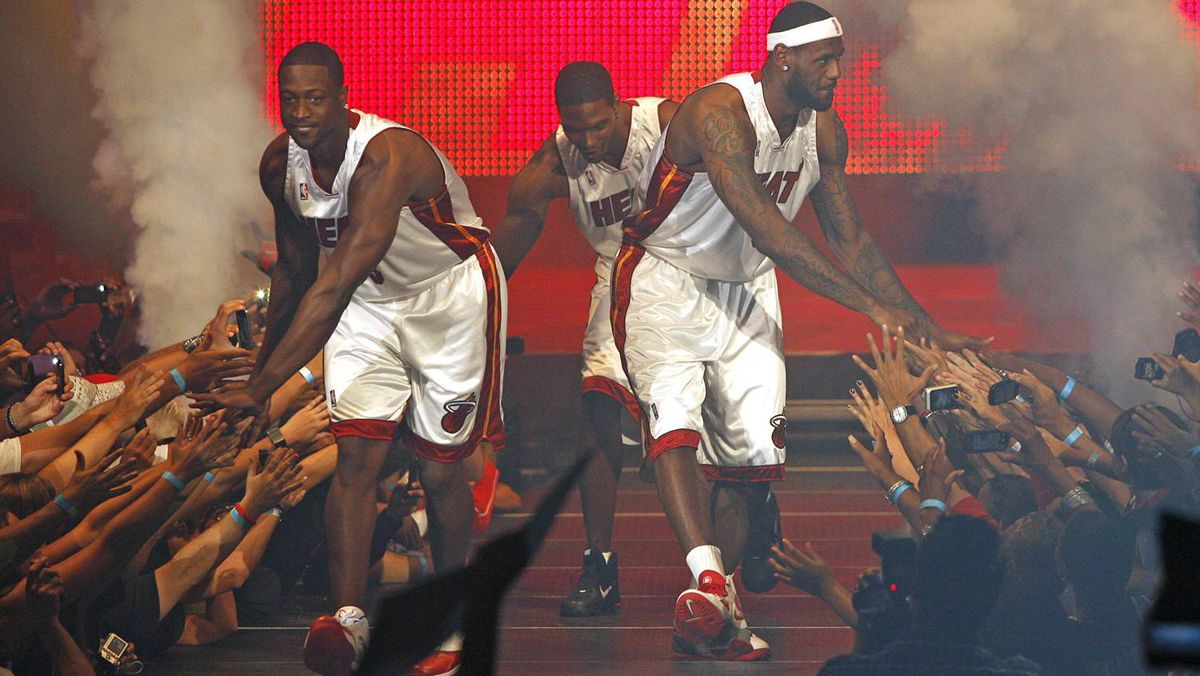 Dwyane Wade (L), Chris Bosh (C) and LeBron James greet guests at NBA basketball team Miami Heat's 'HEAT Summer of 2010 Welcome Event' at the American Airlines Arena in Miami, Florida July 9, 2010.