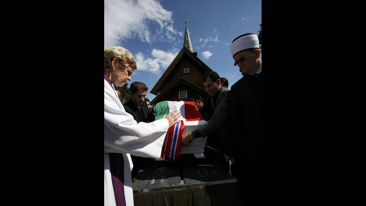 Iman Christian cleric Anne Marie Tronvik (L) and Senaid Kobilica (R), chairman of the Islamic Council of Norway, prepare for the funeral ceremony of Bano Rashid, 18, at Nesodden church near Oslo July 29, 2011.