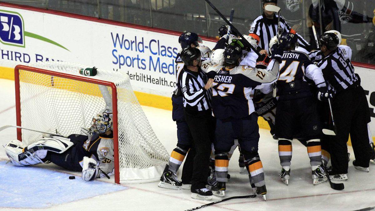 Officials break up the Nashville Predators and Anaheim Ducks after the Ducks knocked Predators' goalie Pekka Rinne (L) into the goal. The Predators won 4-2. REUTERS/M. J. Masotti Jr.