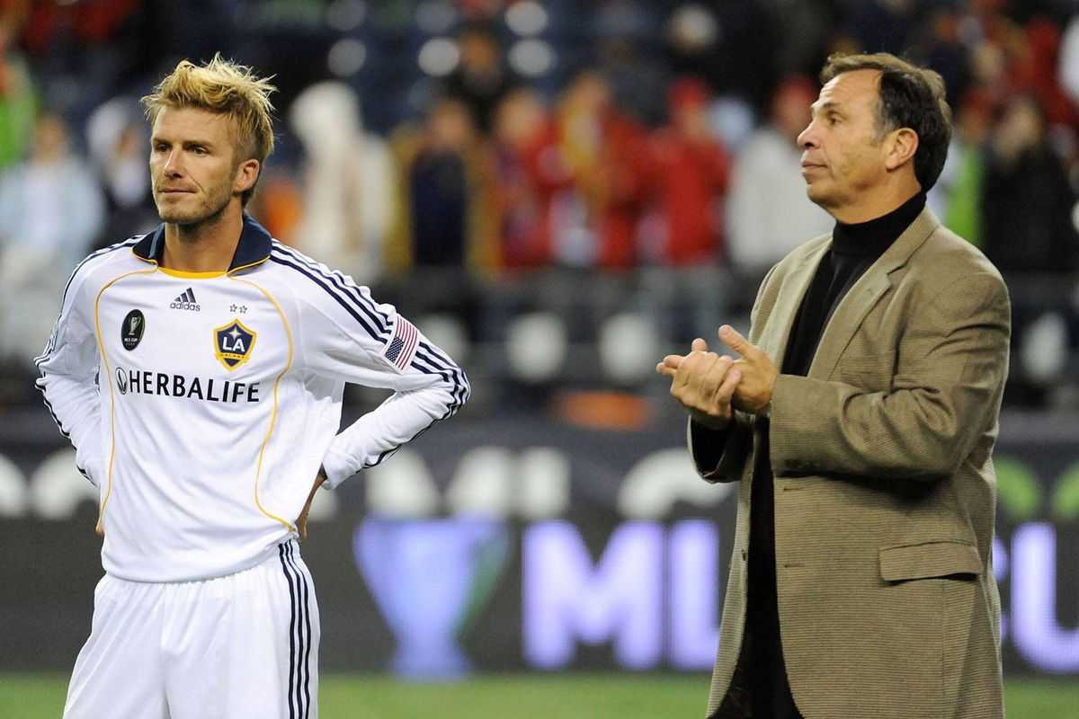David Beckham and Los Angeles coach Bruce Arena watch Real Salt Lake celebrate their MLS Cup victory Sunday over the Galaxy.