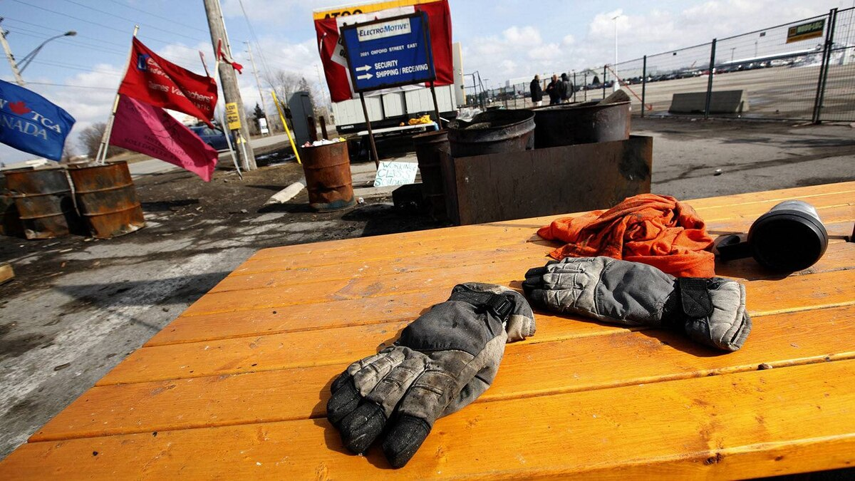 A pair of gloves and a coffee cup are left on the table on the mostly empty picket line at Electro-Motive Canada, following a vote by the employees agreeing to take a severance package negotiated by the CAW and the company in London, Feb. 23, 2012.
