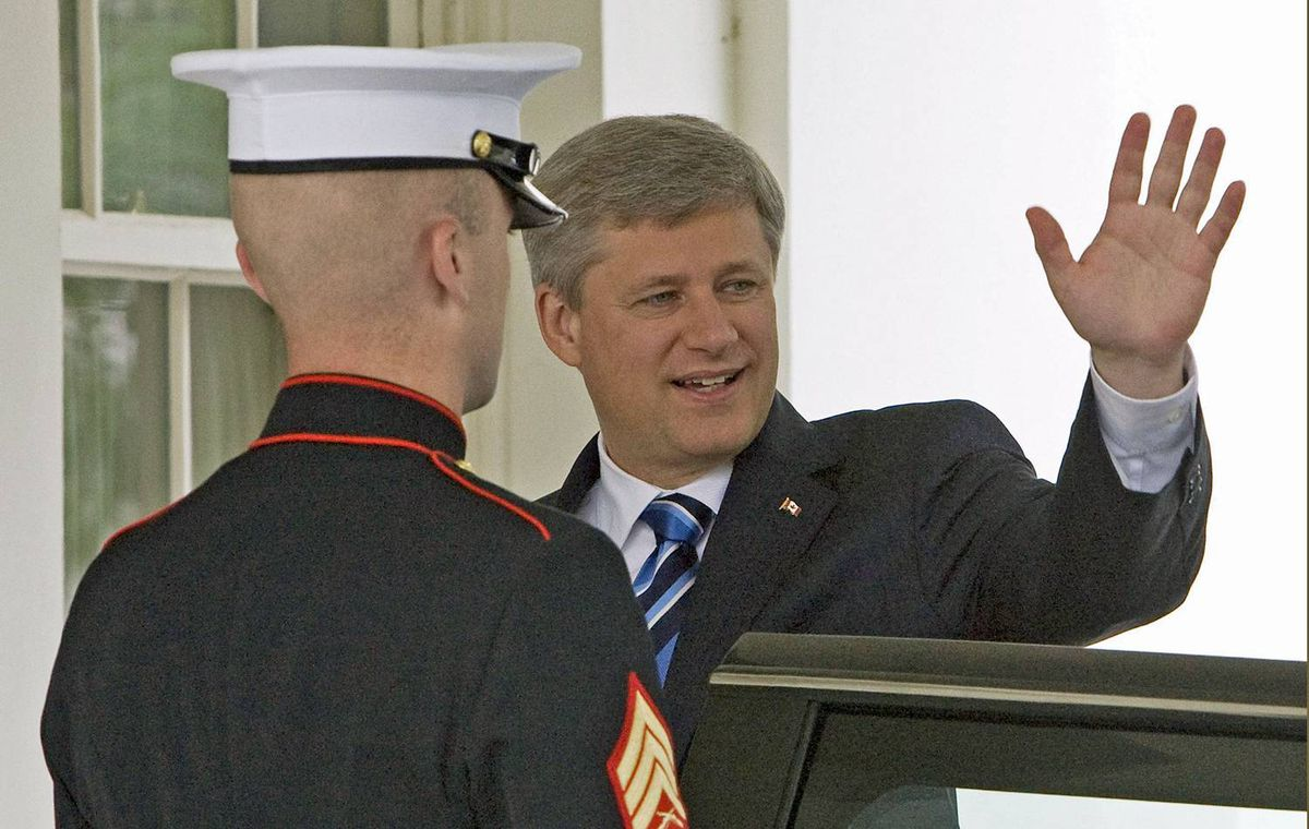 Prime Minister Stephen Harper waves before his meeting with U.S. President Barack Obama in the Oval Office on Sept. 16, 2009.