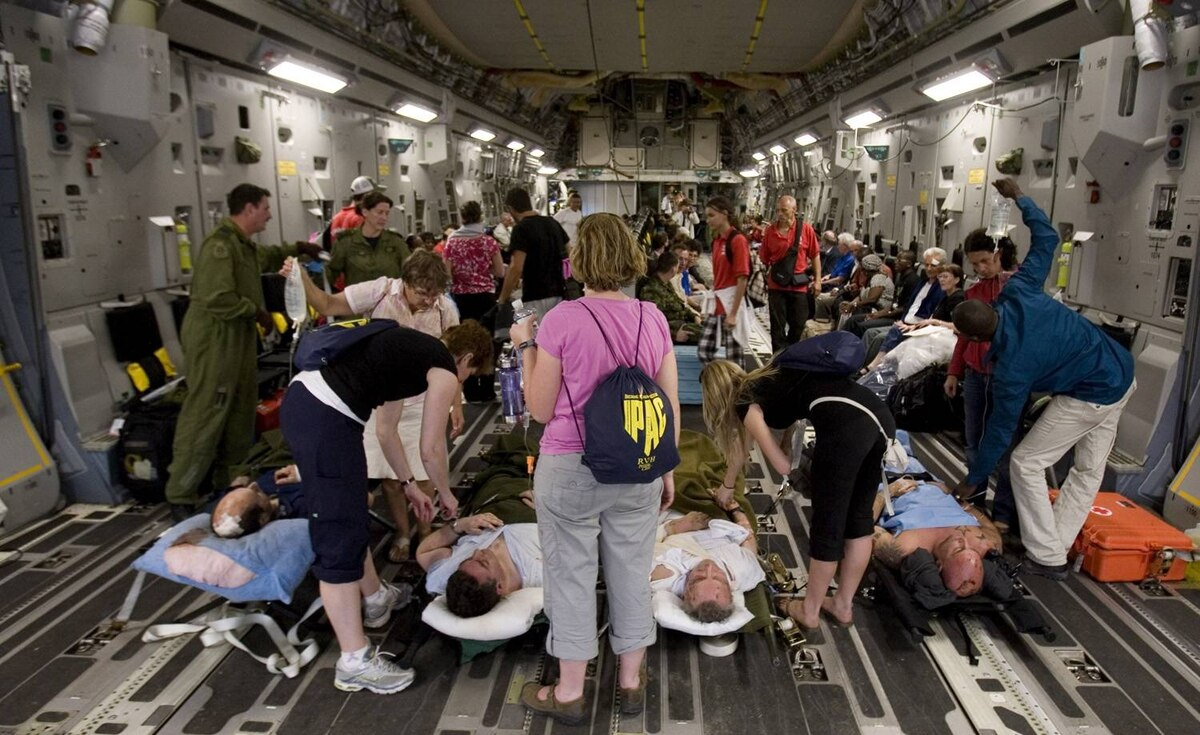 Canadian military personnel, and Canadian RCMP and Surete de Quebec officers working for the UN in Haiti assist and evacuate 97 walking Canadians and five on stretchers onto a C17 plane.