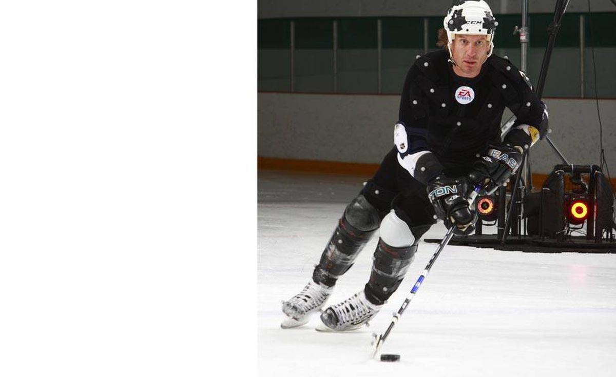 San Jose Sharks' Jeremy Roenick skates with the puck during a motion capture session in Burnaby, B.C., September 9, 2008. The NHL 09 video game was launched today and motion capture of six NHL hockey players was done on the ice surface by Electronic Arts staff.