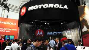 Participants are seen in a Motorola stand at the Mobile World Congress, the world's largest mobile phone trade show, in Barcelona, Spain, Monday, Feb. 27, 2012.
