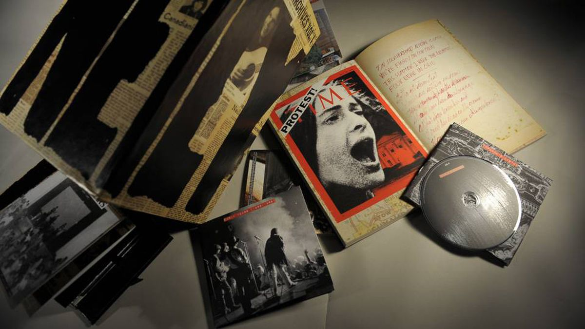 Studio photographs of a Neil Young box set that comes with 10 discs, a reproduction journal which has lyrics, photographs etc..