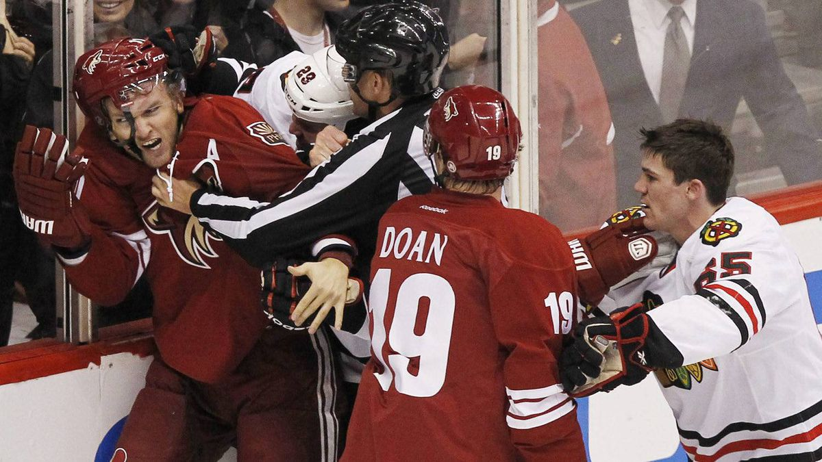 Phoenix Coyotes' Martin Hanzal, left, of the Czech Republic, battles Chicago Blackhawks' Bryan Bickell (29) as linesman Shane Heyer tries to break up the scuffle while Coyotes' Shane Doan (19) and Blackhawks' Andrew Shaw, right, push one another during the first period in Game 1 of an NHL hockey Stanley Cup first-round playoff series Thursday, April 12, 2012, in Glendale, Ariz. The Coyotes defeated the Blackhawks 3-2.(AP Photo/Ross D. Franklin)
