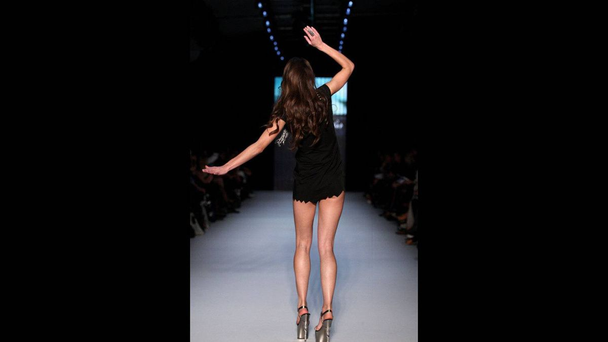 A model showcases designs by None the Richer in the Women's RTW 2 on the catwalk during Rosemount Australian Fashion Week Spring/Summer 2011/12 at Overseas Passenger Terminal on May 3, 2011 in Sydney.