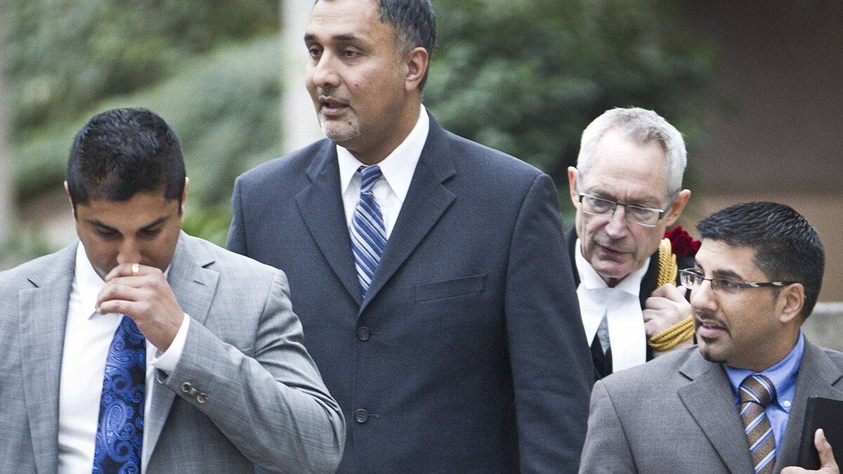 Aneal Basi (L), Dave Basi (centre left), his Lawyer Michael Bolton (centre right) and Bob Virk (R) leave BC Supreme Court October 18, 2010.