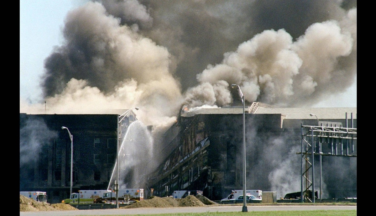 Firefighters battle a blaze at the Pentagon Tuesday, Sept. 11, 2001, after the building took a direct, devasting hit from an aircraft.