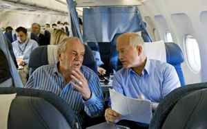 NDP Leader Jack Layton goes over his speaking notes with Ed Broadbent aboard the campaign plane in Toronto on Oct. 10, 2008.