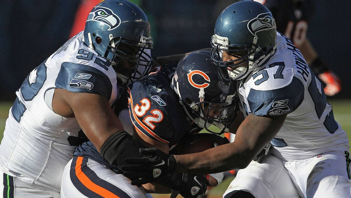 Kahlil Bell #32 of the Chicago Bears is tackled by Brandon Mebane #92 and David Hawthorne #57 of the Seattle Seahawks at Soldier Field on December18, 2011 in Chicago, Illinois. The Seahawks defeated the Bears 38-14.(Photo by Jonathan Daniel/Getty Images)