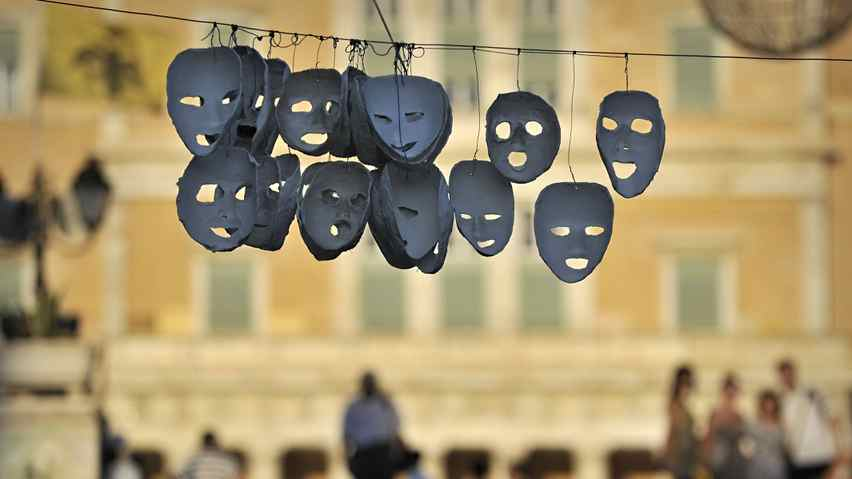 Masks hung by protesters hang at the occupied central Athens Syntagma square, opposite of the Greek Parliament on July 11, 2011.