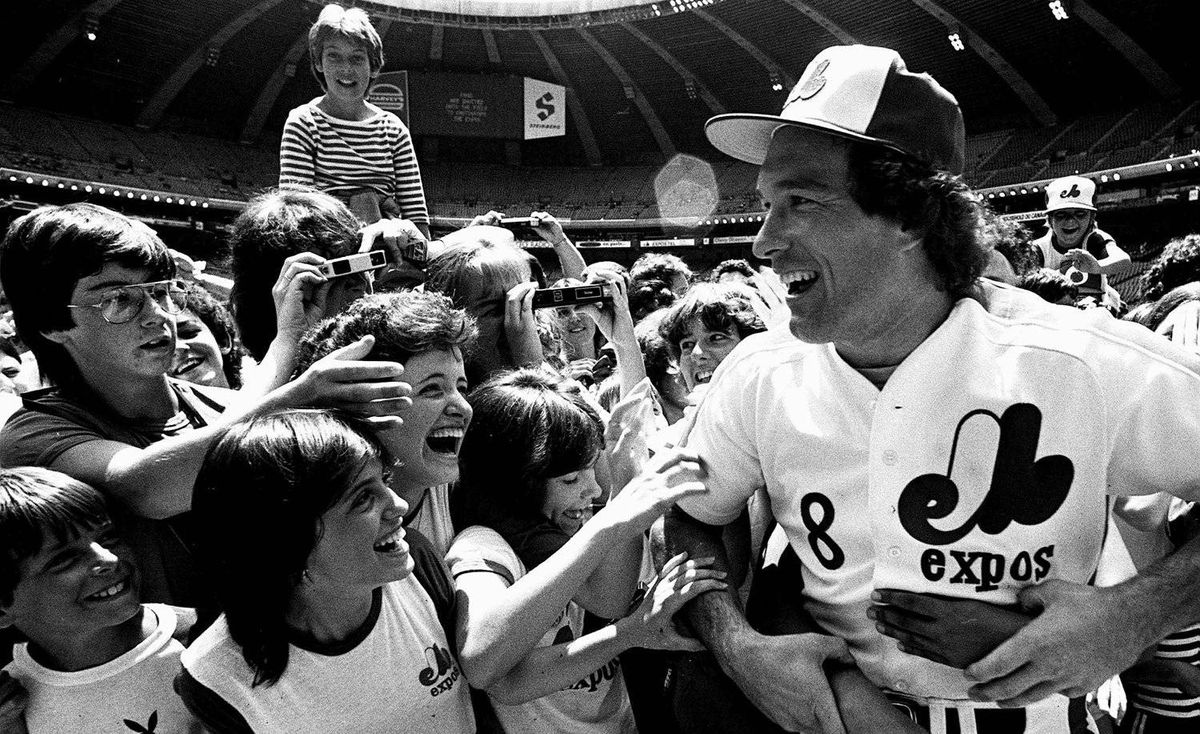 In this June 24, 1983 file photo, Montreal Expos catcher Gary Carter is mobbed by admiring fans at camera day prior to a baseball game against the Pittsburgh Pirates in Montreal. Baseball Hall of Fame president Jeff Idelson said Thursday, Feb. 16, 2012, that Hall of Fame catcher Gary Carter has died.