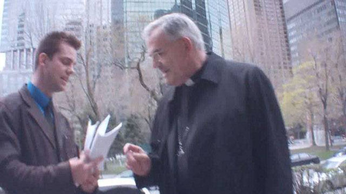 A hidden camera shows Bishop James Wingle being served with a statement of claim in Montreal.