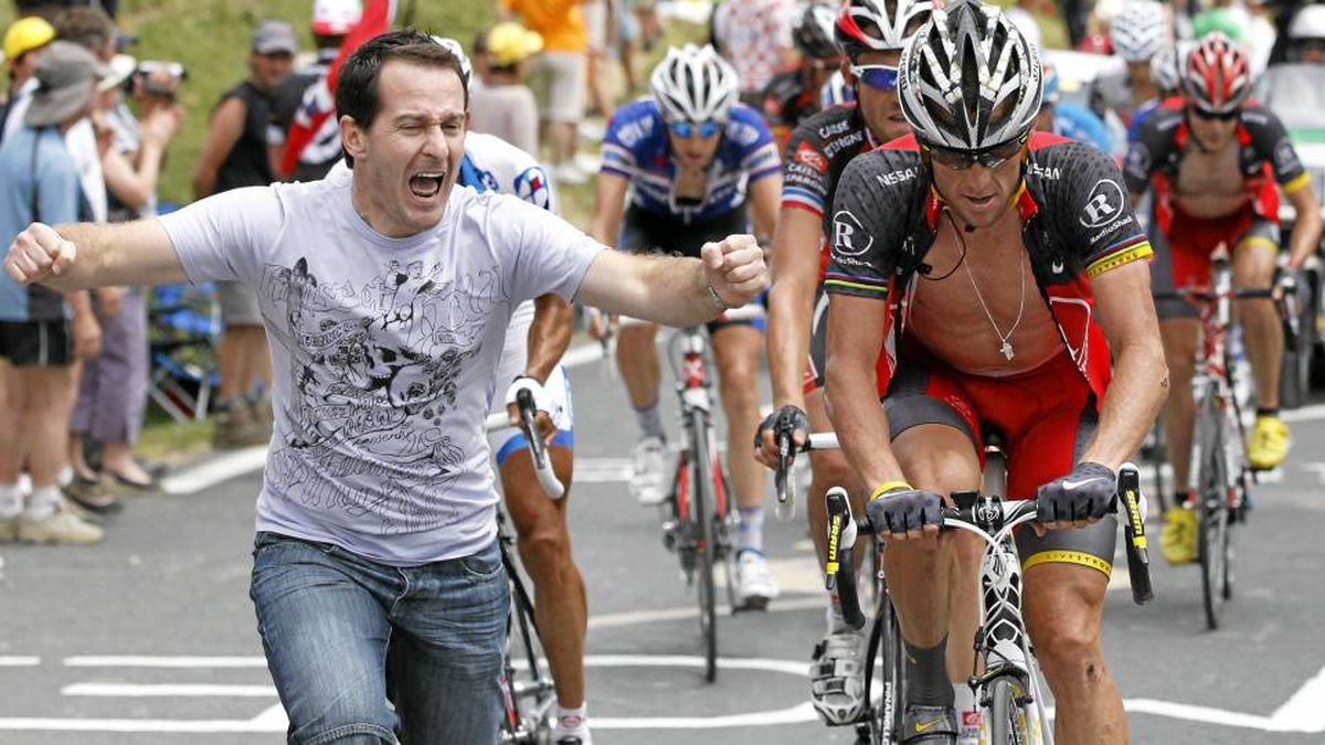 Lance Armstrong is cheered on by a fan as he rides in the Col du Tourmalet pass during the 16th stage of the 2010 Tour de France on July 20, 2010.